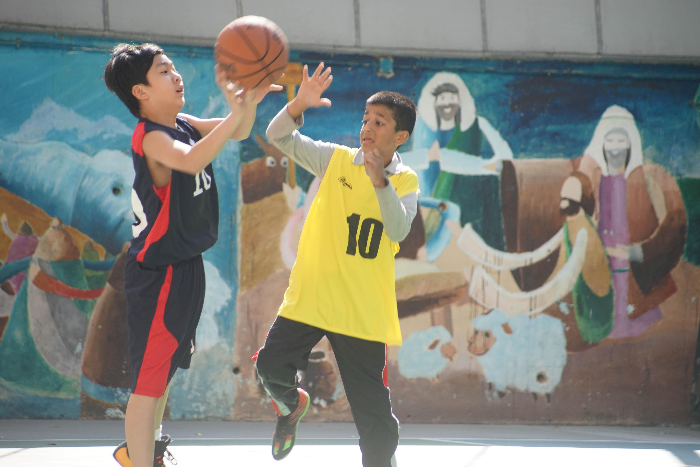 天主教慈幼會伍少梅中學的小學籃球賽相片3
